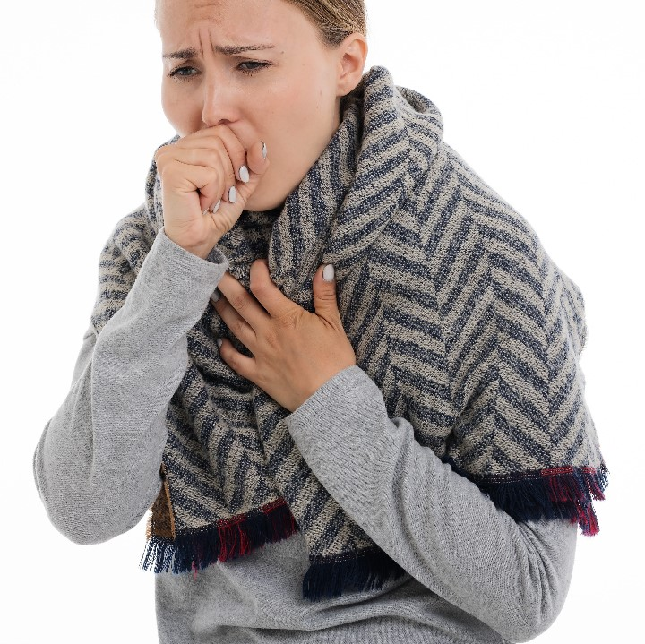 Woman coughing - Coronavirus disinfection services